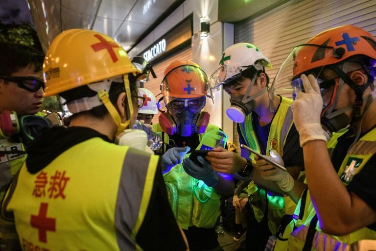 Nurses, doctors, medical students and ordinary people with first aid training have all clamoured to join what has become a small volunteer corps helping treat people on the frontlines of the Hong Kong protests (AFP Photo/ANTHONY WALLACE)