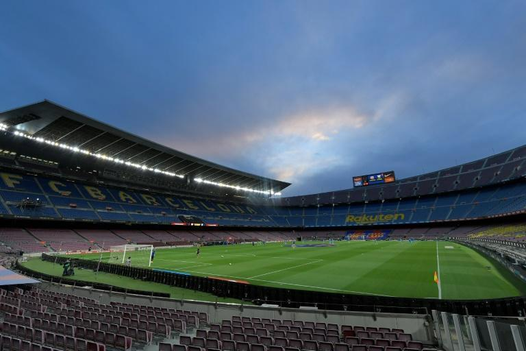 Barcelona's Camp Nou lies empty, but La Liga hopes limited crowds can be allowed to attend matches before the delayed season finishes (AFP Photo/LLUIS GENE)