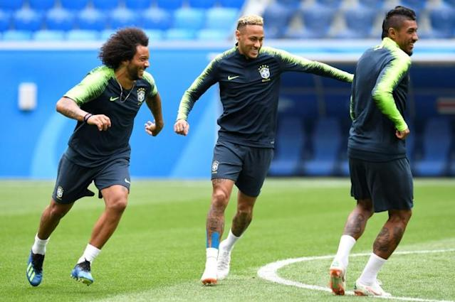 Brazil's (from L) Marcelo, Neymar and Paulinho attend a training session in Saint Petersburg on June 21, on the eve of their Russia 2018 World Cup Group E match against Costa Rica
