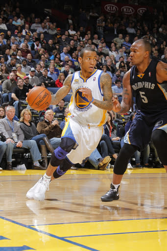 OAKLAND, CA - MARCH 07: Monta Ellis #8 of the Golden State Warriors drives the ball against Marreese Speights #5 of the Memphis Grizzlies on March 07, 2012 at Oracle Arena in Oakland, California. (Photo by Rocky Widner/NBAE via Getty Images)