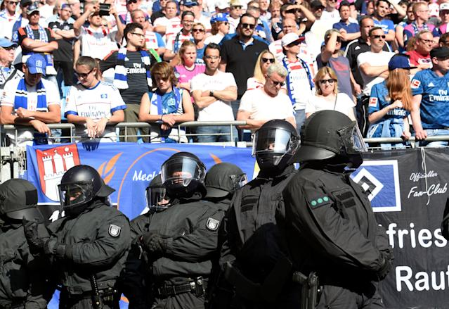 Soccer Football - Bundesliga - Hamburger SV v Borussia Moenchengladbach - Volksparkstadion, Hamburg, Germany - May 12, 2018 Riot police in the stadium during the match as Hamburg fans look dejected REUTERS/Fabian Bimmer DFL RULES TO LIMIT THE ONLINE USAGE DURING MATCH TIME TO 15 PICTURES PER GAME. IMAGE SEQUENCES TO SIMULATE VIDEO IS NOT ALLOWED AT ANY TIME. FOR FURTHER QUERIES PLEASE CONTACT DFL DIRECTLY AT + 49 69 650050
