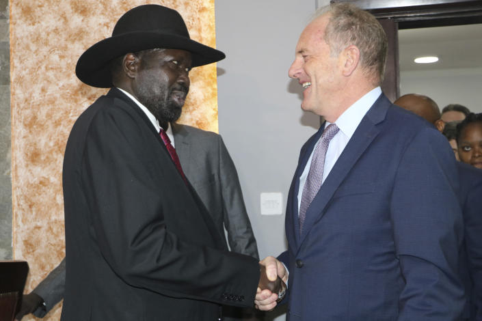 South Sudan's President Salva Kiir, left, shakes hands with U.N. chief, David Shearer, right, during meetings with the U.N. Security Council on Sunday, Oct. 20, 2019, about the status of the country's peace deal. Machar made an impassioned plea to a visiting United Nations Security Council delegation that met with him and President Salva Kiir to urge speedier progress in pulling the country out of a five-year civil war. (AP Photo/Sam Mednick)