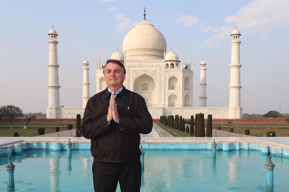 TOPSHOT - Brazilian President Jair Bolsonaro poses for pictures as he visits the Taj Mahal in Agra on January 27, 2020. (Photo by STR / AFP) (Photo by STR/AFP via Getty Images)
