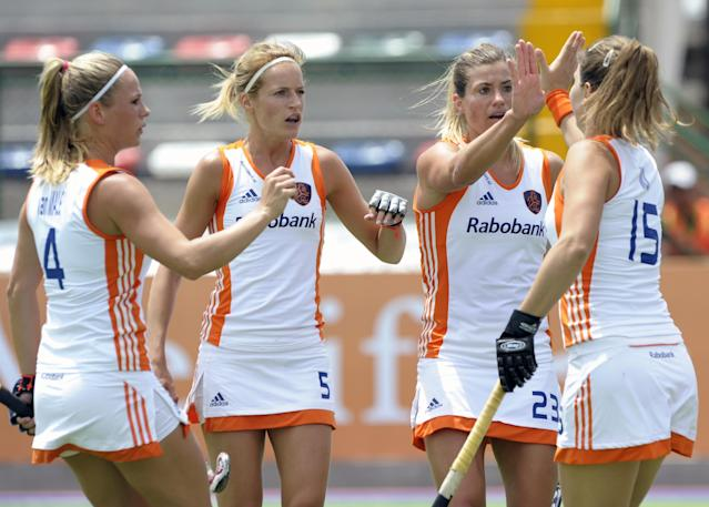 The Netherlands' Kim Lammers (2-R) celebrates with teammates Sabine Mol (R), Carlien Dirkse (2-L) and Kitty Van Male after scoring the team's first goal against Japan during their Champions Trophy 2012 field hockey match in Rosario, Santa Fe, Argentina, on January 31, 2012. AFP PHOTO / Juan Mabromata (Photo credit should read JUAN MABROMATA/AFP/Getty Images)