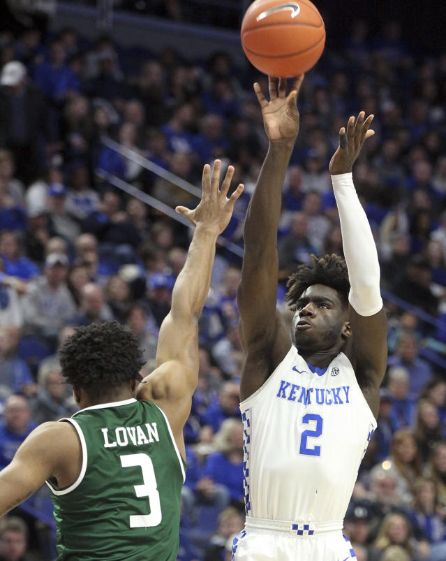 Kentucky's Kahlil Whitney (2) shoots while defended by UAB's Tavin Lovan (3) during the first half of an NCAA college basketball game in Lexington, Ky., Friday, Nov. 29, 2019. (AP Photo/James Crisp)