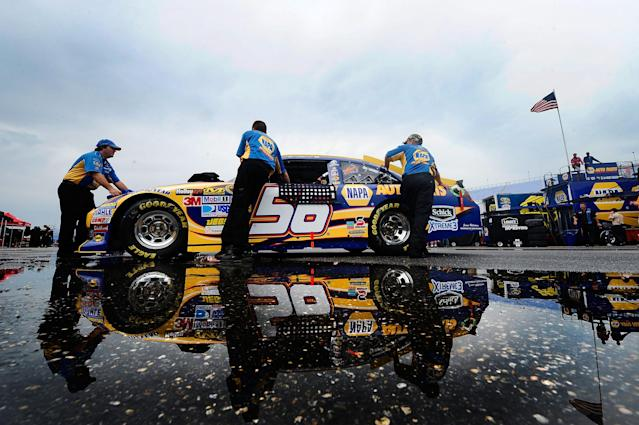 TALLADEGA, AL - MAY 06: Crew members push the #56 NAPA Auto Parts Toyota through the garage area prior to the NASCAR Sprint Cup Series Aaron's 499 at Talladega Superspeedway on May 6, 2012 in Talladega, Alabama. (Photo by Jared C. Tilton/Getty Images)
