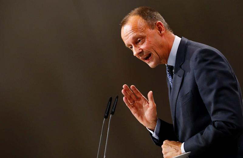 Candidate for the party chair Friedrich Merz delivers a speech at the Christian Democratic Union (CDU) party congress in Hamburg, Germany, December 7, 2018. REUTERS/Fabrizio Bensch