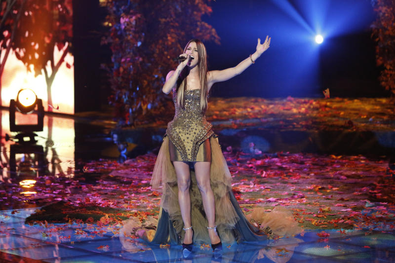 "This Monday, Dec. 17, 2012 file photo released by NBC shows Cassadee Pope performing on ""The Voice,"" ""Live Show"" Episode 323A on the part one season 3 finale in Los Angeles. Three contestants, Pope, Terry McDermott and Nicholas David vie for the title in the NBC reality show. (AP Photo/NBC, Tyler Golden)"