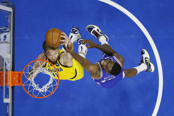 Indiana Pacers' Domantas Sabonis, left, and Philadelphia 76ers' Shake Milton leap for a rebound during the first half of an NBA basketball game, Monday, March 1, 2021, in Philadelphia. (AP Photo/Matt Slocum)
