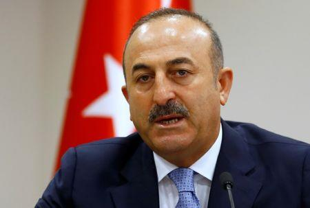 Turkey's Foreign Minister Mevlut Cavusoglu addresses the media in Ankara