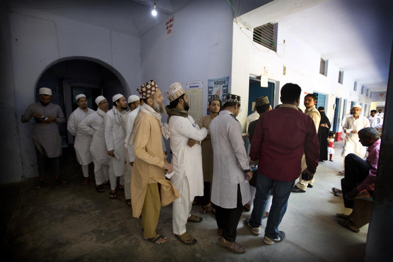 Indian Muslims stand in a queue to cast their votes at a polling station in Varanasi, India, Sunday, May 19, 2019. Indians are voting in the seventh and final phase of national elections, wrapping up a 6-week-long long, grueling campaign season with Prime Minister Narendra Modi's Hindu nationalist party seeking reelection for another five years. Counting of votes is scheduled for May 23. (AP Photo/Rajesh Kumar Singh)