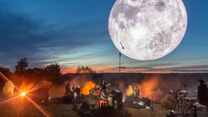 """Damon Albarn performs in the Stone Circle as part of the Glastonbury Festival Global Livestream """"Live at Worthy Farm"""" at Worthy Farm, Pilton on May 19, 2021 in Glastonbury, England"""