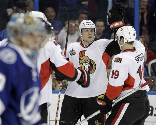 Ottawa Senators left wing Colin Greening, center, celebrates with center Jason Spezza (19) after scoring a goal against the Tampa Bay Lightning during the first period of an NHL hockey game Tuesday, March 6, 2012, in Tampa, Fla. (AP Photo/Chris O'Meara)