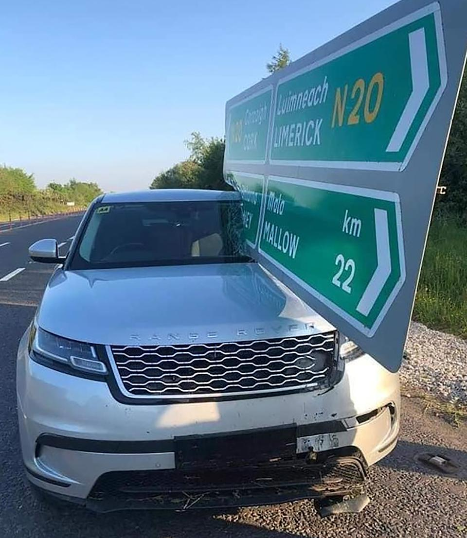 A Land Rover Range Rover with a green sign piercing the windshield.