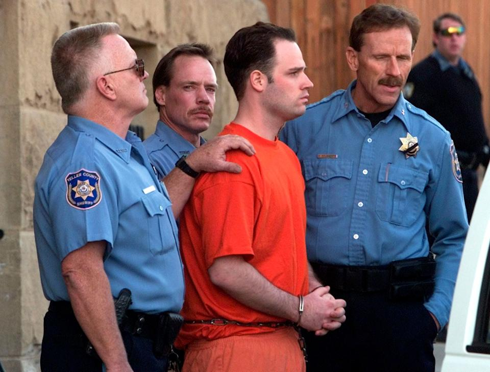 Randy Halprin, one of the Texas 7 prison escapees, is led out of the Teller County Courthouse after an extradition hearing in Cripple Creek, Colorado, on Jan. 26, 2001. (Photo: Reuters)