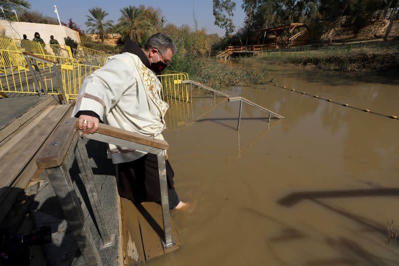 Pilgrims take part in a baptism ceremony in West Bank amid pandemic