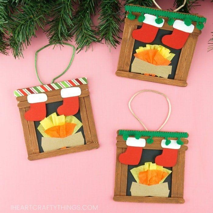 "<p>Use popsicle sticks to build a fireplace in this craft. Fill it with a roaring fire using yellow and orange crepe paper. Hang stockings from the mantle, and use cording to create a loop for hanging your ornament.</p><p><em><a href=""https://iheartcraftythings.com/fireplace-craft.html"" rel=""nofollow noopener"" target=""_blank"" data-ylk=""slk:Get the tutorial from I Heart Crafty Things»"" class=""link rapid-noclick-resp"">Get the tutorial from I Heart Crafty Things»</a></em><br></p>"