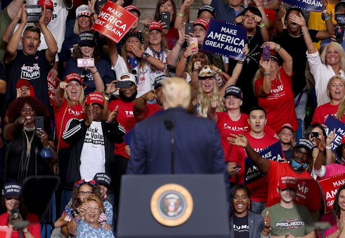 Supporters of U.S. President Donald Trump react as he concludes speaking at a campaign rally at the BOK Center, June 20, 2020 in Tulsa, Oklahoma. (Photo by Win McNamee/Getty Images)