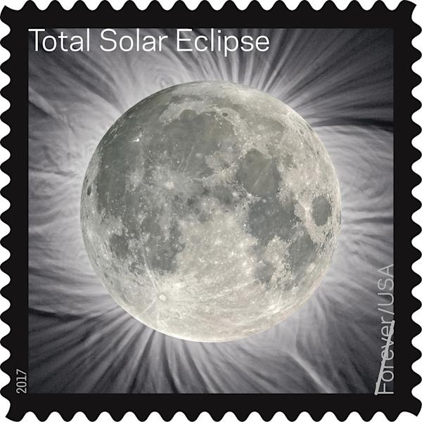 This image provided by the U.S. Postal Service shows a Total Solar Eclipse Forever stamp. The stamp, that when touched transforms the image of the blacked-out sun into the moon, comes out in June 2017, on the Summer Solstice. (U.S. Postal Service via AP)