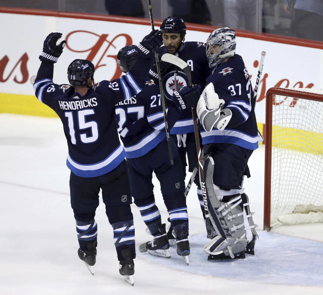 Hellebuyck is 28-8-8 with a .923 save percentage this season. (Trevor Hagan/The Canadian Press via AP)