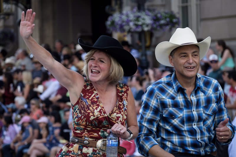 <p>Albert Premier Rachel Notley, left, and Alberta Finance Minister Joe Ceci were all smiles at the opening parade for the Calgary Stampede on July 6, 2018. Photo from The Canadian Press. </p>