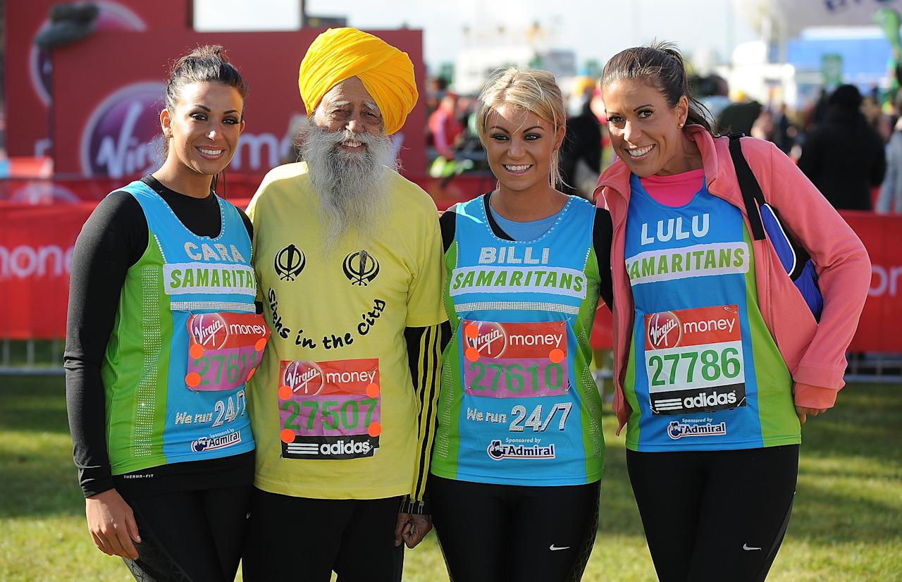 LONDON, ENGLAND - APRIL 22:  Cara Kilbey, Fauja Singh, Billi Mucklow and their friend Lulu pose for the camera during the Virgin London Marathon 2012 on April 22, 2012 in London, England.  (Photo by Christopher Lee/Getty Images)