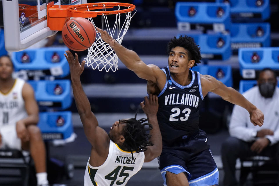 Baylor guard Davion Mitchell (45) shoots on Baylor forward Jonathan Tchamwa Tchatchoua (23) in the second half of a Sweet 16 game in the NCAA men's college basketball tournament at Hinkle Fieldhouse in Indianapolis, Saturday, March 27, 2021. (AP Photo/AJ Mast)