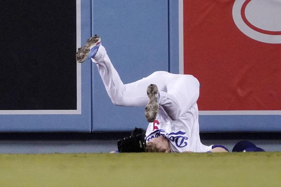Dodgers second baseman Gavin Lux falls after missing a catch.