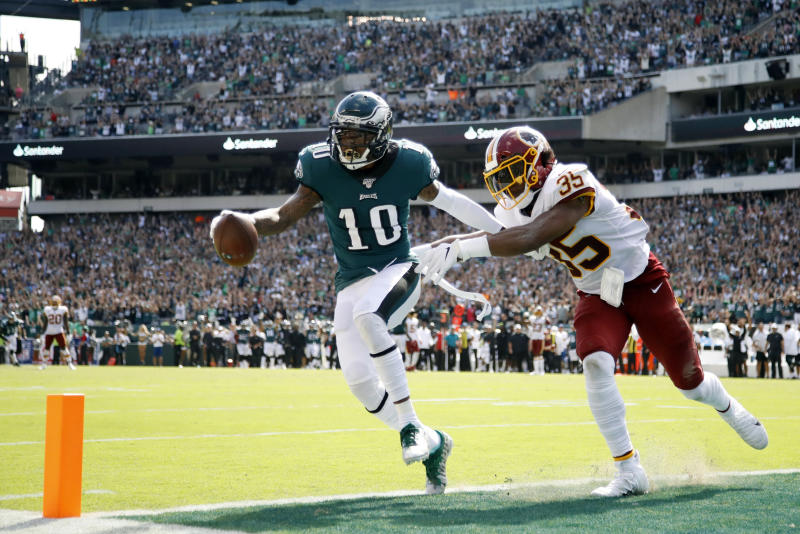 FILE - In this Sunday, Sept. 8, 2019, file photo, Philadelphia Eagles' DeSean Jackson, left, scores a touchdown against Washington Redskins' Montae Nicholson during the second half of an NFL football game in Philadelphia. Jackson's return to Philly couldn't have gone much better. He made eight receptions for 154 yards and a pair of 50-plus-yard TD catches in sparking the Eagles' rally from a 17-0 hole against the Redskins. (AP Photo/Matt Rourke, File)