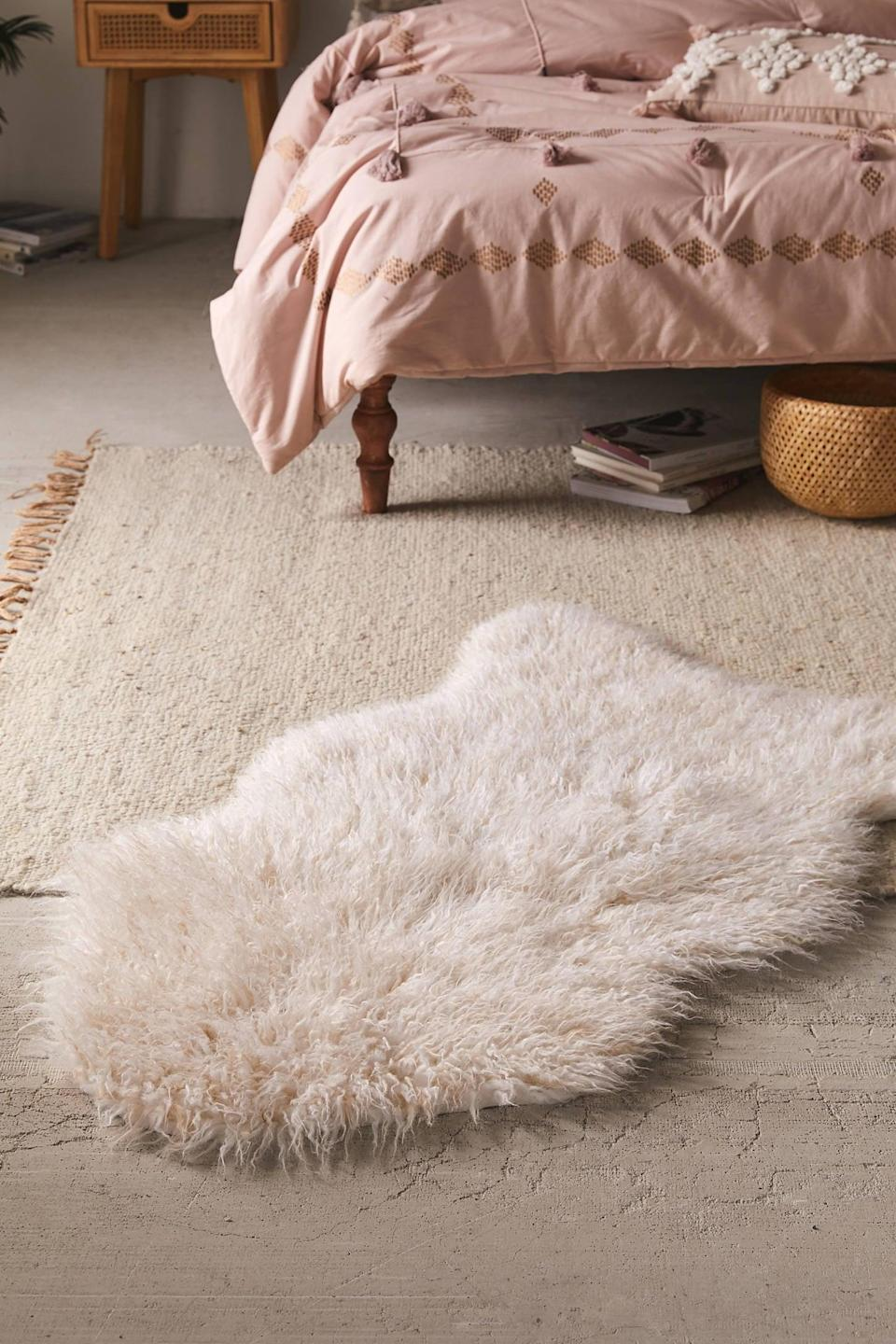 """<p>This <a href=""""https://www.popsugar.com/buy/Mazzy-Faux-Fur-Shaped-Rug-546166?p_name=Mazzy%20Faux%20Fur%20Shaped%20Rug&retailer=urbanoutfitters.com&pid=546166&price=54&evar1=casa%3Aus&evar9=45186448&evar98=https%3A%2F%2Fwww.popsugar.com%2Fhome%2Fphoto-gallery%2F45186448%2Fimage%2F47350008%2FMazzy-Faux-Fur-Shaped-Rug&list1=shopping%2Curban%20outfitters%2Chome%20decor%2Csmall%20space%20living%2Cdecor%20shopping&prop13=mobile&pdata=1"""" class=""""link rapid-noclick-resp"""" rel=""""nofollow noopener"""" target=""""_blank"""" data-ylk=""""slk:Mazzy Faux Fur Shaped Rug"""">Mazzy Faux Fur Shaped Rug</a> ($54-$118, originally $59-$129) comes in three different sizes.</p>"""