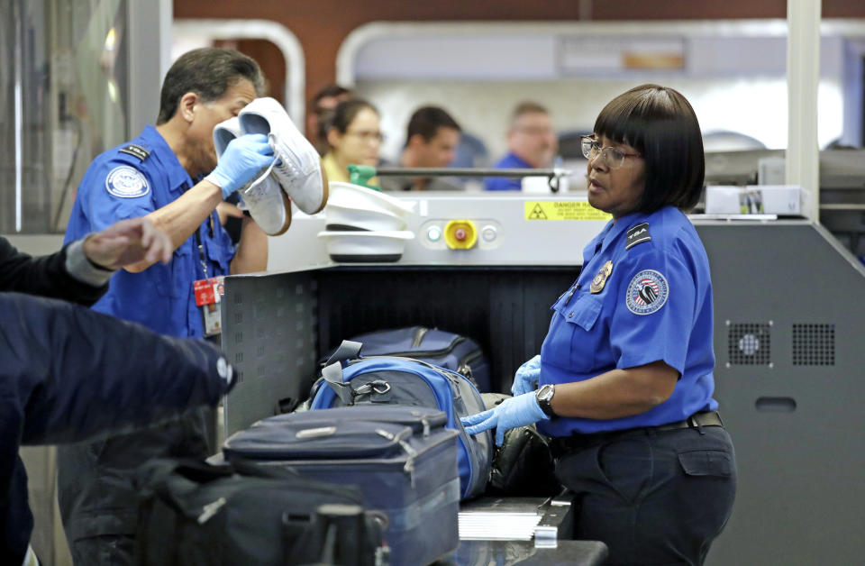 Government shutdown protests coming from the TSA could delay a lot of travel. (Photo credit: AP Photo/Elaine Thompson)