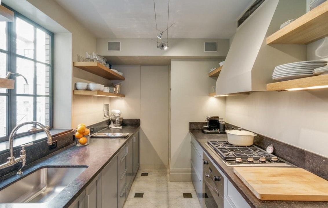 OK,deep breaths. While this may not look like an extraordinary kitchen to you if you live outside of New York,trust: It's a rare thing to find sprawling counters, a chef's oven, and gorgeous recessed lighting  not to mention ample natural light, storage, and shelving.Sigh.