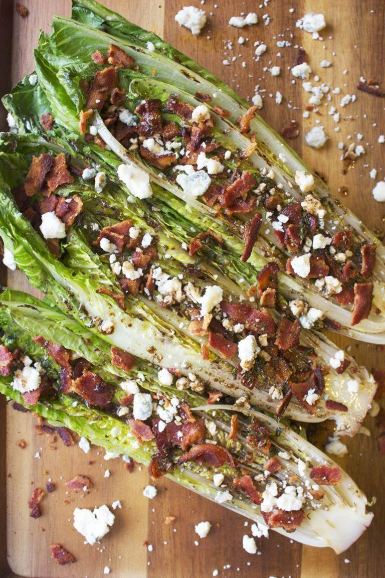 """<p>Before you make the same old salad as last night, take a look at this inspired recipe. A homemade balsamic dressing is the kicker.</p><p><strong>Get the recipe at <a href=""""http://www.thegarlicdiaries.com/grilled-romaine-salad-with-bacon-and-blue-cheese/"""" rel=""""nofollow noopener"""" target=""""_blank"""" data-ylk=""""slk:The Garlic Diaries"""" class=""""link rapid-noclick-resp"""">The Garlic Diaries</a>.</strong></p><p><strong><a class=""""link rapid-noclick-resp"""" href=""""https://go.redirectingat.com?id=74968X1596630&url=https%3A%2F%2Fwww.walmart.com%2Fip%2FThe-Pioneer-Woman-Timeless-Beauty-Pre-Seasoned-Plus-20-Cast-Iron-Double-Griddle%2F117723541&sref=https%3A%2F%2Fwww.thepioneerwoman.com%2Ffood-cooking%2Fmeals-menus%2Fg32188535%2Fbest-grilling-recipes%2F"""" rel=""""nofollow noopener"""" target=""""_blank"""" data-ylk=""""slk:SHOP GRIDDLES"""">SHOP GRIDDLES </a></strong><strong><br></strong></p>"""