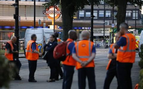 Transport officials outside Southgate Tube station - Credit: Tolga Akmen/LNP