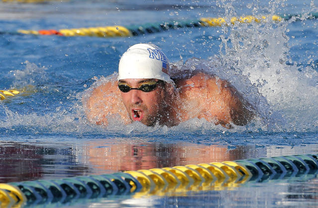 Michael Phelps competes in the 100-meter butterfly final during the Arena Grand Prix, Thursday, April 24, 2014, in Mesa, Ariz. Phelps was competing for the first time since the 2012 London Olympics. He finished second in the event. (AP Photo/Matt York)