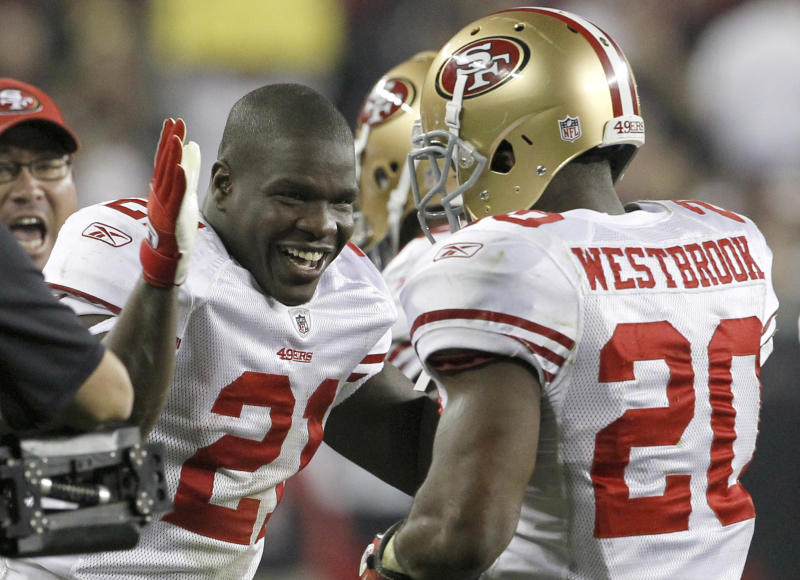 San Francisco 49ers' Brian Westbrook (20) celebrates his touchdown against the Arizona Cardinals with teammate Frank Gore (21) during the second quarter of an NFL football game Monday, Nov. 29, 2010, in Glendale, Ariz. (AP Photo/Ross D. Franklin)