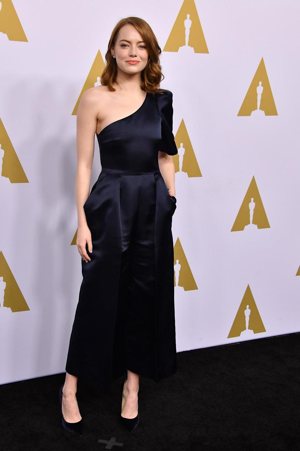 <p>The 'La La Land' actress stunned in a deep blue jumpsuit by Stella McCartney, which boasted a very trendy off-the-shoulder design and statement sleeve. [Photo: Getty] </p>