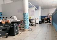 COVID-19 patients receive treatment at Charles Nicole Hospital in Tunis