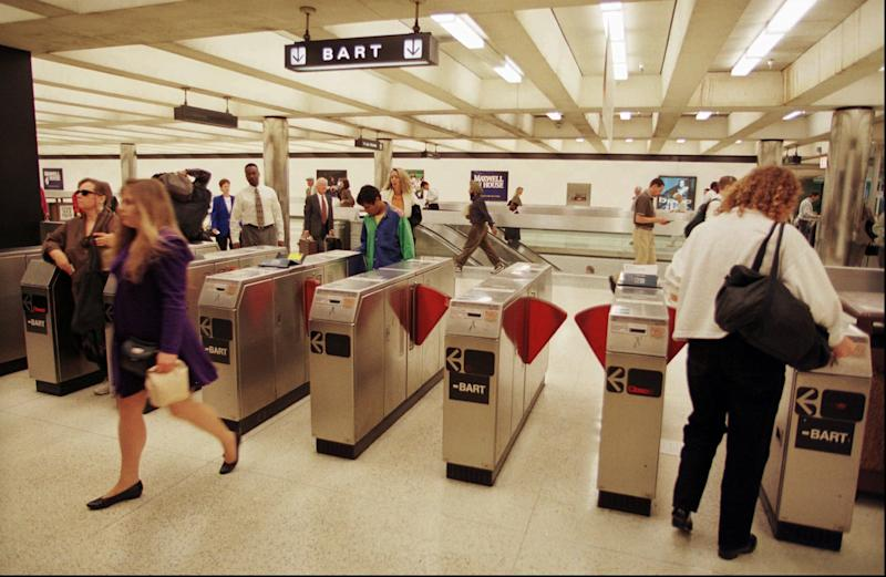 FILE - Commuters enter and exit a Bay Area Rapid Transit station in San Francisco's financial district in this Sept. 15, 1997 file photo. Officials with the Bay Area Rapid Transit system, better known as  BART, said Friday Aug. 12, 2011 that they blocked cellphone reception in San Francisco train stations for three hours to disrupt planned demonstrations over a police shooting. (AP Photo/Robin Weiner, File)