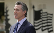 FILE - In this Friday, May 22, 2020, file photo, California Gov. Gavin Newsom speaks during a news conference at the Veterans Home of California in Yountville, Calif. A federal appeals court has denied a Southern California church's request to overturn the state's coronavirus restrictions barring worship services indoors during the coronavirus pandemic. The Sacramento Bee says Friday, Jan. 22, 2021, ruling by the 9th U.S. Circuit Court of Appeals leaves the door open for addressing Gov. Gavin Newsom administration's limits on church attendance if a California county is in a less-restrictive COVID-19 tier. (AP Photo/Eric Risberg, Pool, File)
