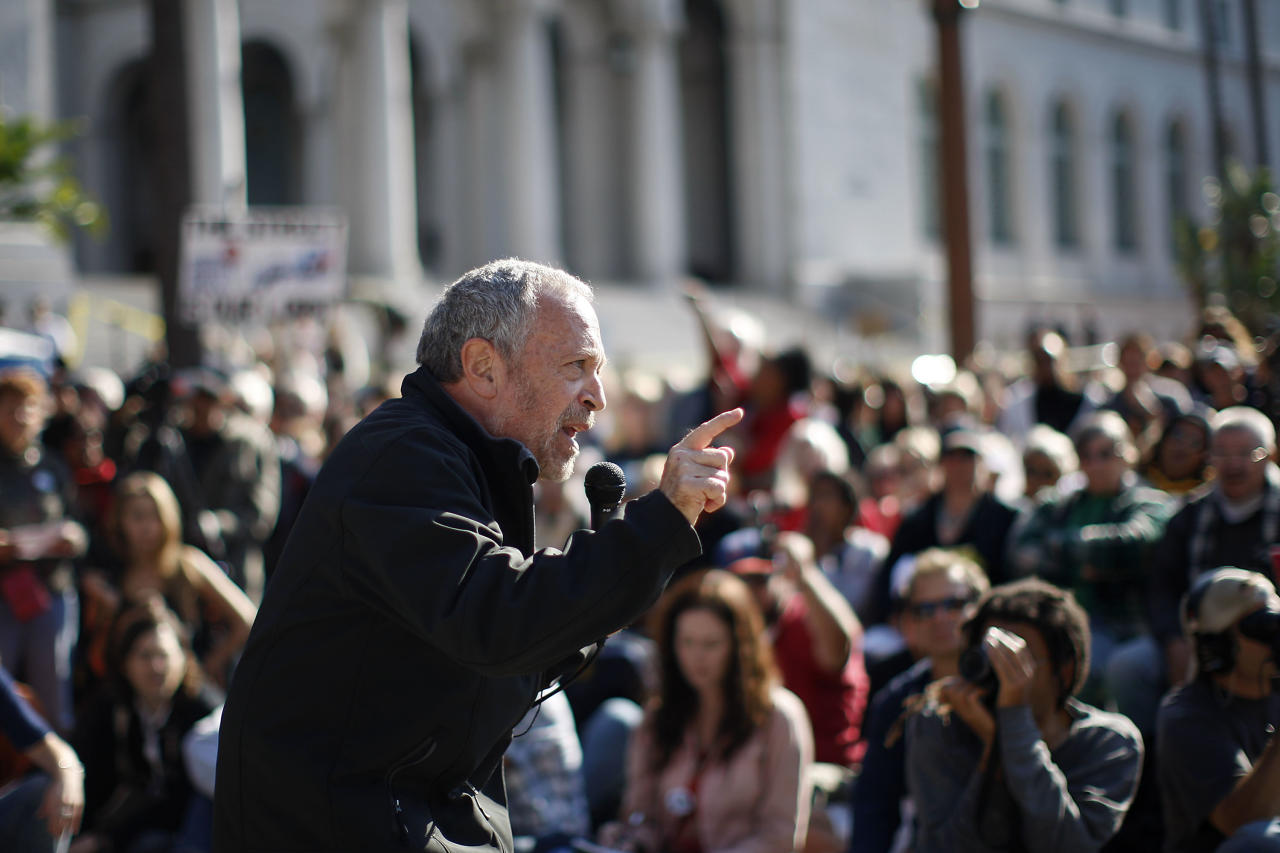 LOS ANGELES, CA - NOVEMBER 5:  Former U.S. Secretary of Labor Robert Reich speaks to Occupy Los Angeles protesters after the Move Your Money March through the downtown financial district during what is being called Bank Transfer Day, on November 5, 2011 in Los Angeles, California. Occupy movement members are calling for people to move their money from banks to credit unions today in support of the 99% movement.   (Photo by David McNew/Getty Images)