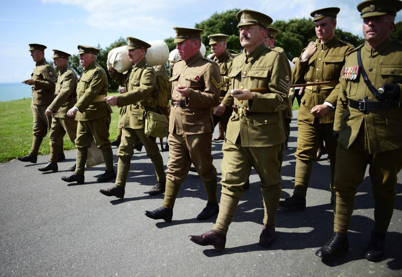 "Members of the Rifles Living Society, wearing uniforms similar to those worn by soldiers in World War One (WW1), march during a ""Short Step"" parade, to mark the 100th anniversary of the outbreak of World War One, in Folkestone, southern England August 4, 2014. REUTERS/Dylan Martinez (BRITAIN - Tags: POLITICS ANNIVERSARY CONFLICT)"
