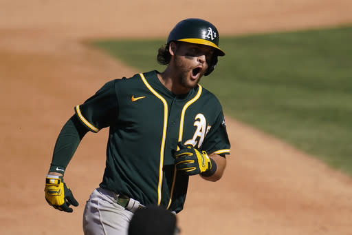 Pinder's HR helps rally A's past Astros 9-7, trail ALDS 2-1