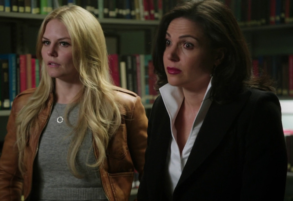 Emma Swan stands with her hands on her hips, and Regina Mills has both eyebrows arched in shock