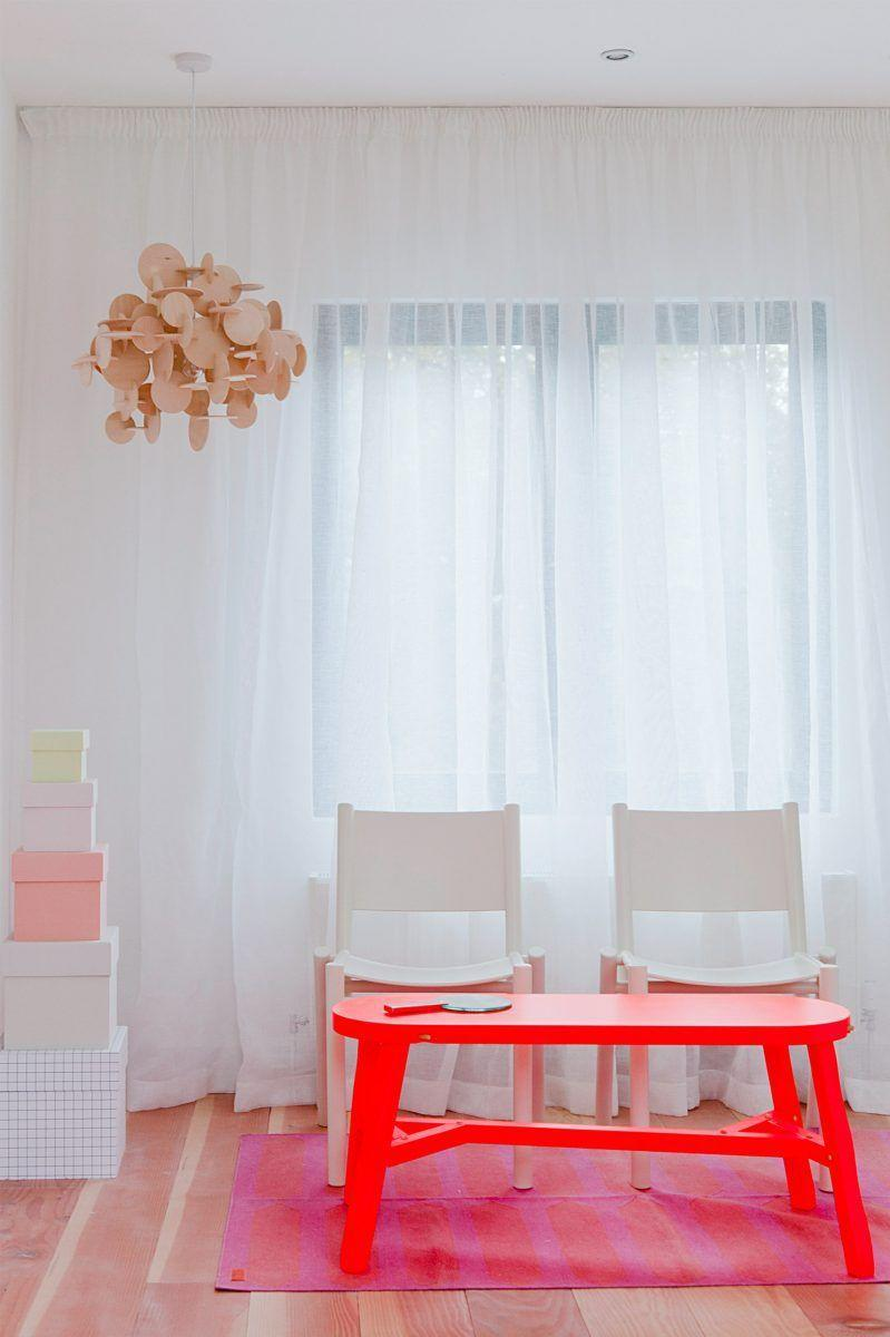 "<p>A playroom is the perfect place to loosen the design reigns and let your inner child take over. But that doesn't mean it has to veer too far away from the rest of the home's general style. In this space designed by <a href=""https://www.heckerguthrie.com/"" rel=""nofollow noopener"" target=""_blank"" data-ylk=""slk:Hecker Guthrie"" class=""link rapid-noclick-resp"">Hecker Guthrie</a>, the neon red coffee table, striped rug, and mobile all contribute to a sense of joy and youthful energy, yet they also outlast the playroom and can be repurposed once the kids get older since it speaks the style of the rest of the home. </p>"