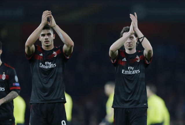 AC Milan's Andre Silva , left, and his teammate Riccardo Montolivo at the end of the Europa League round of 16 second leg soccer match between Arsenal and AC Milan at the Emirates stadium in London, Thursday, March, 15, 2018. (AP Photo/Alastair Grant)