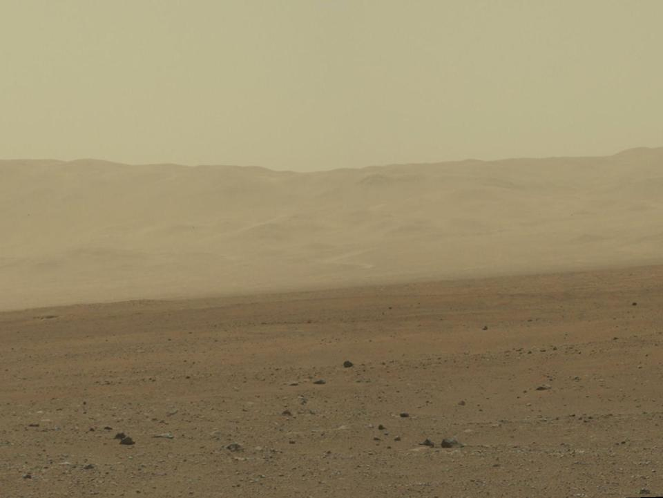 In this handout image provided by NASA/JPL-Caltech/MSSS, a color image from NASA's Curiosity rover's Mast Camera shows part of the wall of Gale Crater, the location on Mars where the rover landed August 5, 2012 on Mars: NASA/JPL-Caltech/MSSS