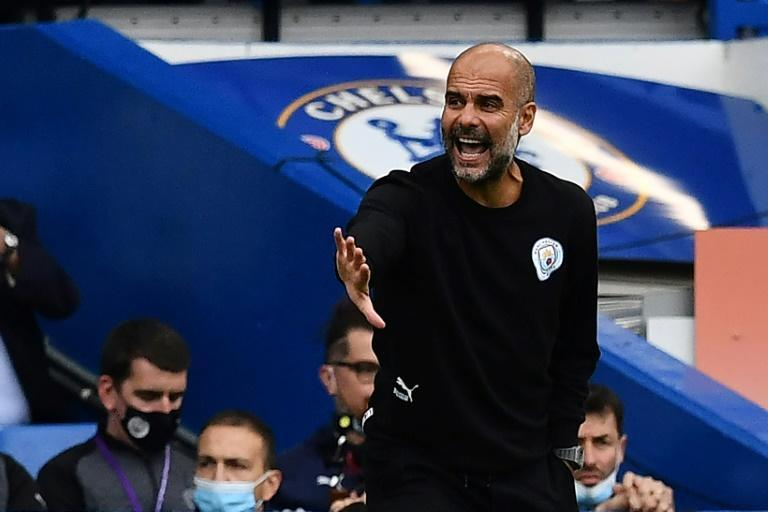 Guardiola says Manchester City lack the 'weapon' of a prolific goal-scorer (AFP/Ben STANSALL)