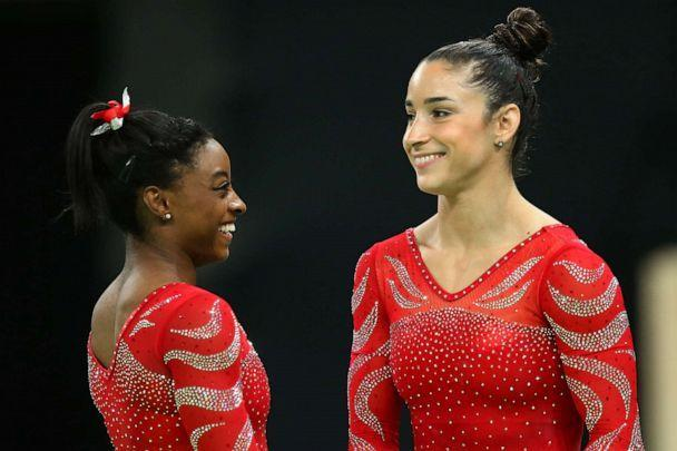 PHOTO: Aly Raisman and Simone Biles look on during an artistic gymnastics training session on Aug. 4, 2016 at the Arena Olimpica do Rio in Rio de Janeiro. (Alex Livesey/Getty Images, FILE)
