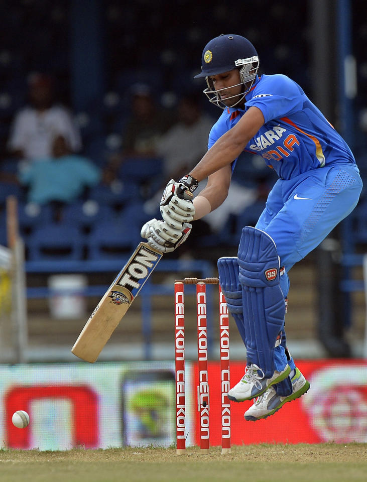 Indian cricketer Rohit Sharma plays a shot during the sixth match of the Tri-Nation series between India and Sri Lanka at the Queen's Park Oval stadium in Port of Spain on July 9, 2013. Sri Lanka won the toss and elected to field first. AFP PHOTO/Jewel Samad